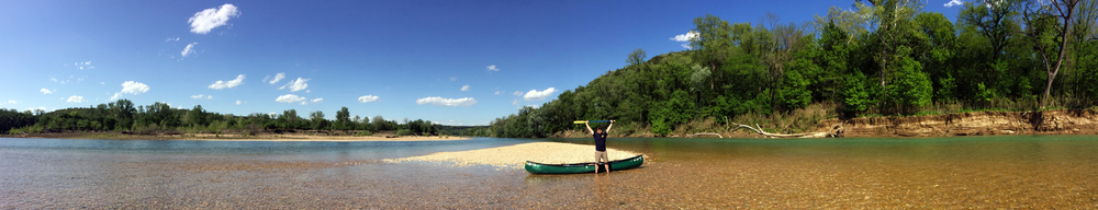 Nate Jordon takes a triumphant break on a Buffalo River gravel bar during his attempt to float the entire river.
