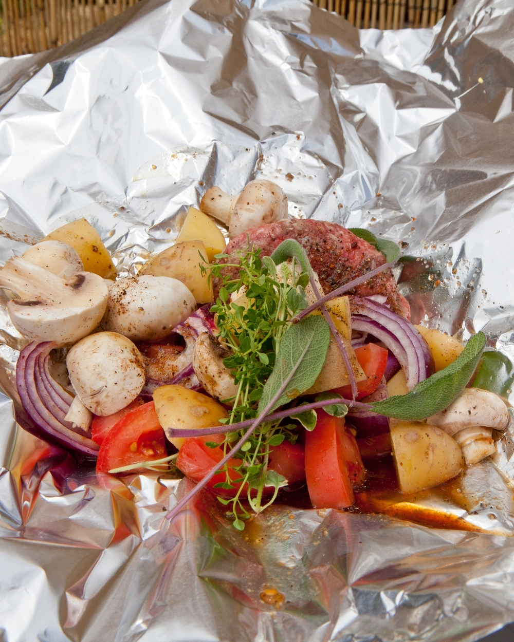 Preparing a hobo meal is quite simple: Place ingredients on aluminum foil then fold into a sealed packet and cook over hot coals. Photos by Matthew Martin