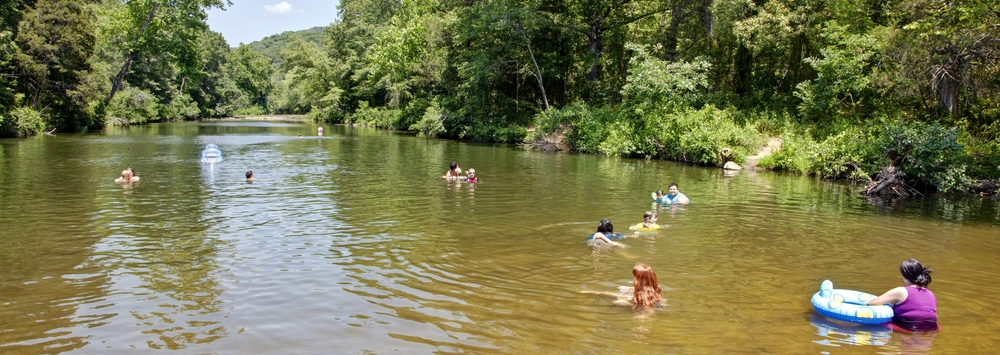 Summertime means swimming time in Arkansas, and Natural Dam is just one of the hot spots that will get you cool.