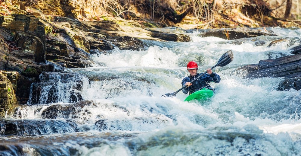 Micah Goodwin is geared up right as he takes on the rushing waters of the Lake Norrell Spillway in Saline County.