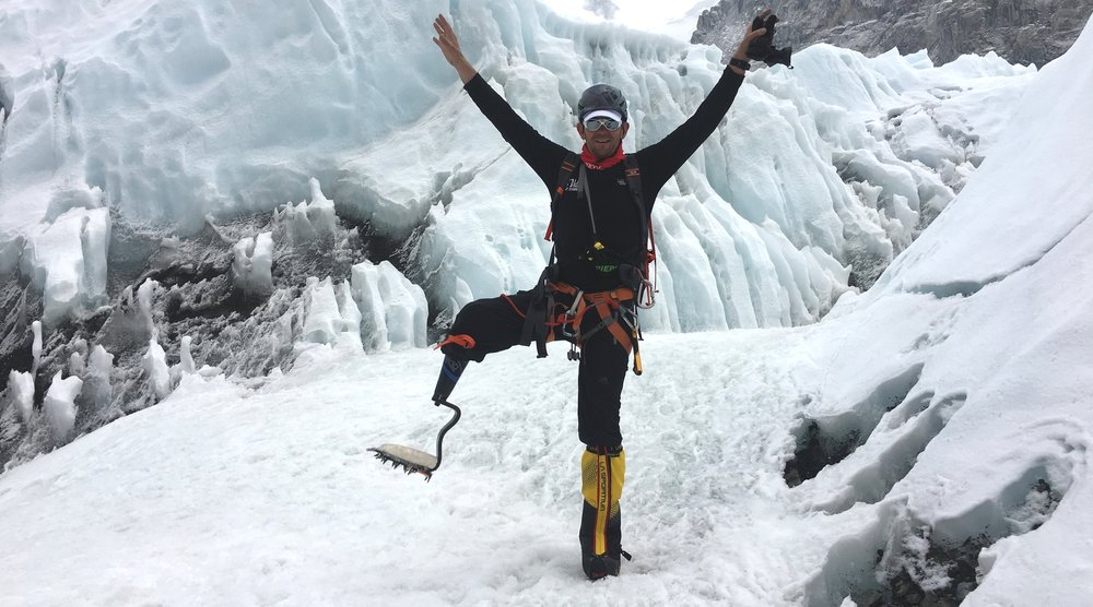 Jeff Glasbrenner shows off his custom-designed carbon-fiber prosthetic leg among the treacherous ice floes of Mount Everest.