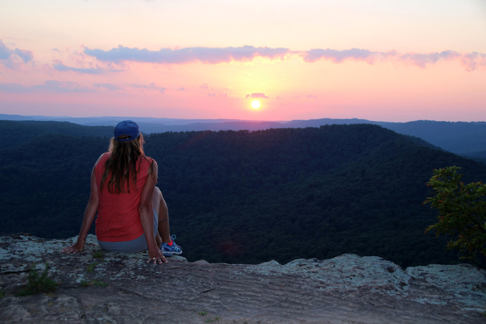 Stacy Price takes in the sunset from White Rock Mountain after driving in from Shores Lake.