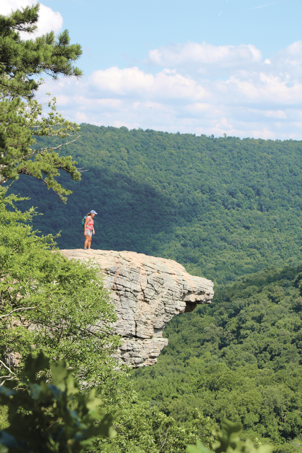 Hawksbill Crag is one of the most photographed spots in Arkansas. Here, Stacy Price peeks over the edge after hiking in from the Cave Mountain Road trailhead near Boxley.