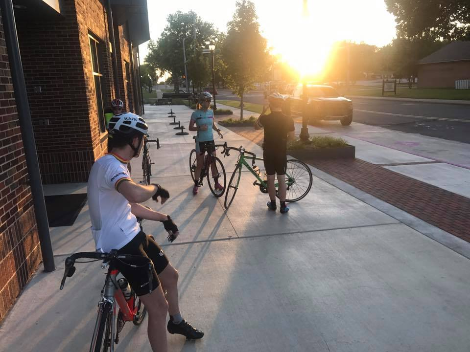 University of Central Arkansas students gather outside the newly built Donaghey Hall for a sunset bike ride.