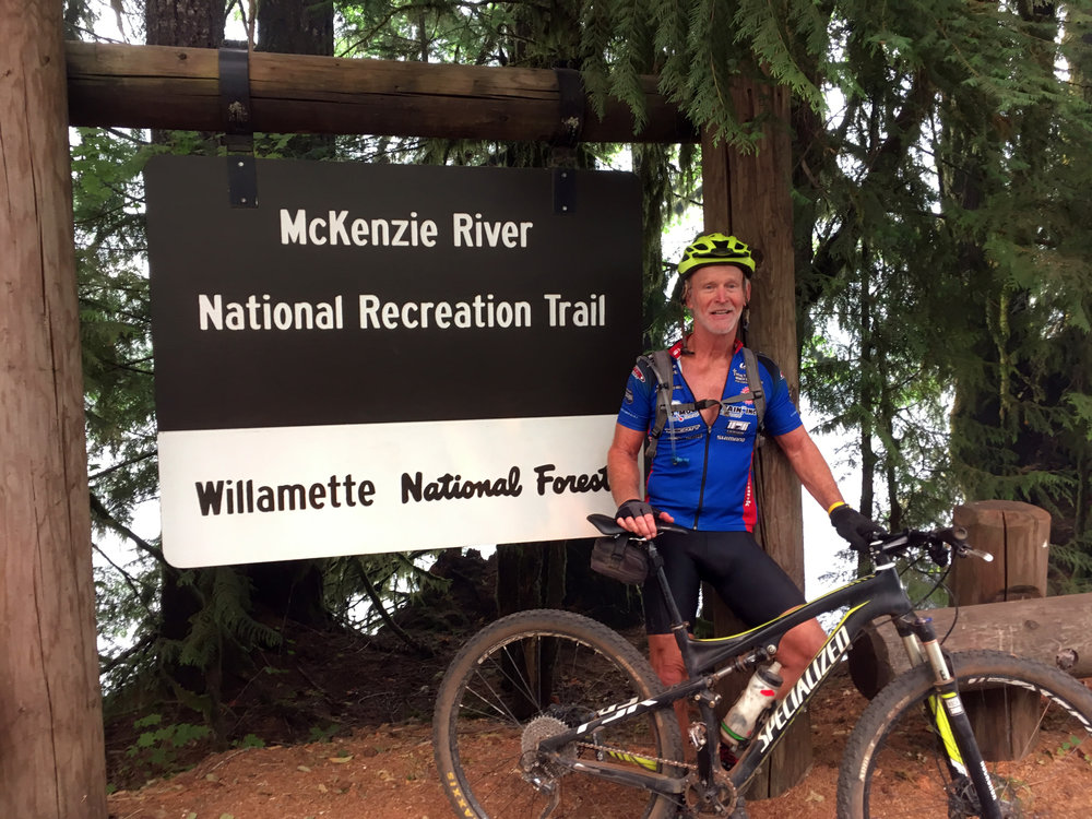 Top to bottom: Sweet rolling single track bordered by giant conifers. Bob with satisfied smile at finish of his McKenzie River Trail Adventure.
