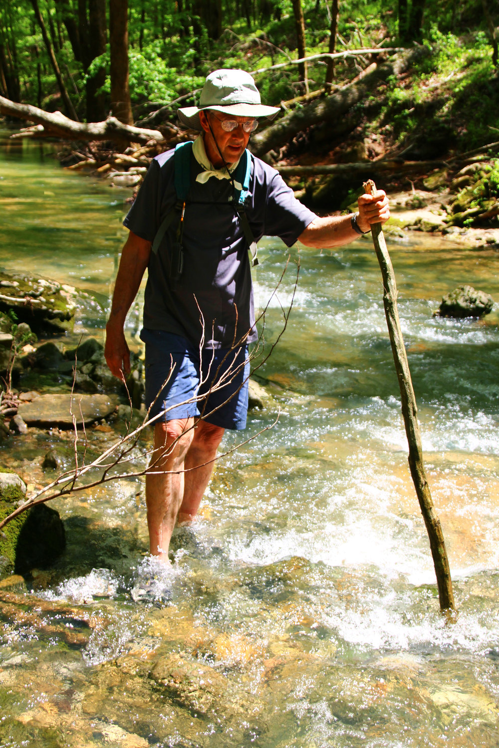 Top: Bill Steward casting a line in the Buffalo River. Below: Bill Steward hiking up Panther Creek en route to Indian Rockhouse.
