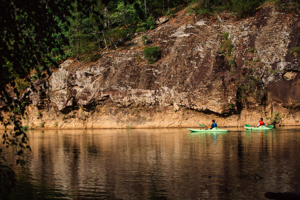 Two paddlers take in the serene beauty of the Little Red River.