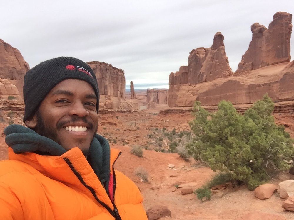 """On a pit stop at Arches National Park, Dr. Sconiers takes a moment to say, """"Cheese!"""""""