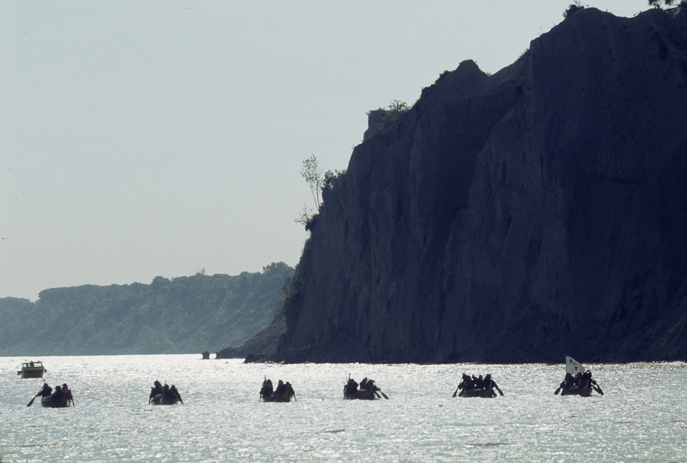 The expedition paddling past the Scarborough Bluffs in August 1976. Photography Credit: members of the La Salle: Expedition II