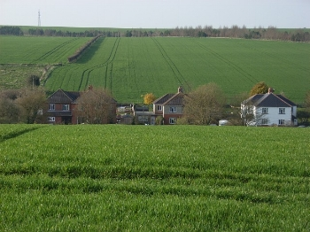 Farmland_and_houses,_Coombe_-_geograph.org.uk_-_396915.jpg
