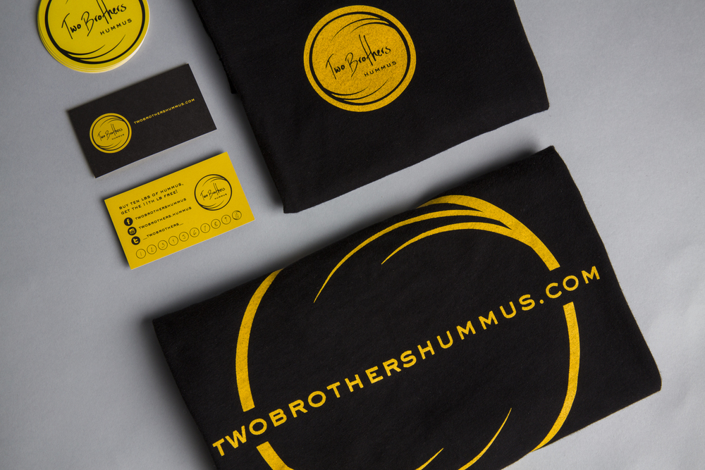 Two Brothers Hummus related collateral; shirt, business punch card and stickers.