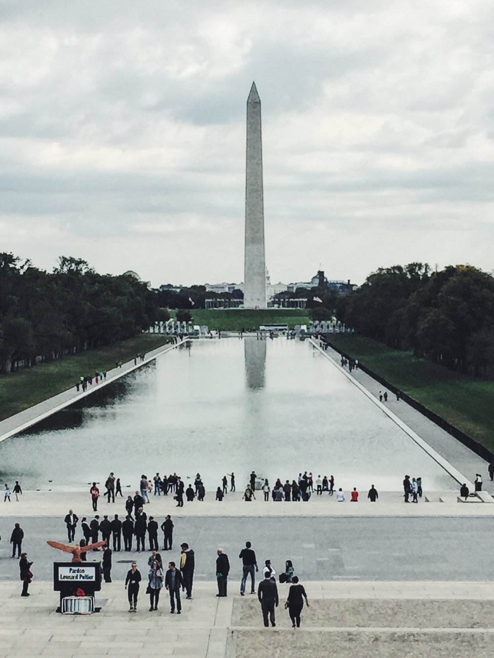 A Photo of the Washington Monument taken in front of the Lincoln Memorial.