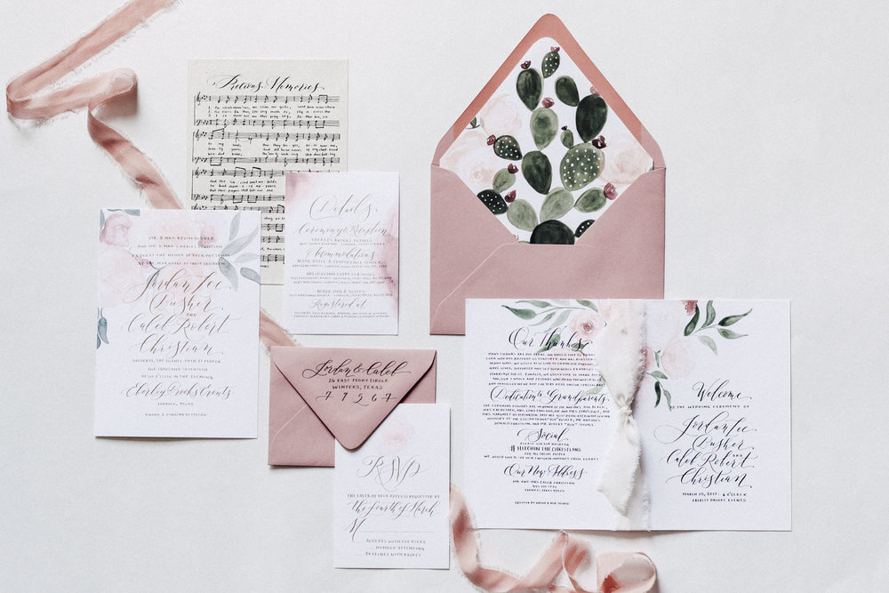 Floral and desert inspired custom hand-painted and hand-lettered wedding invitation suite.