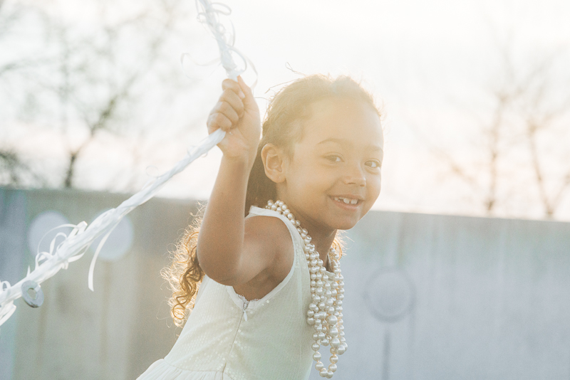 girl running with balloons, styled shoot