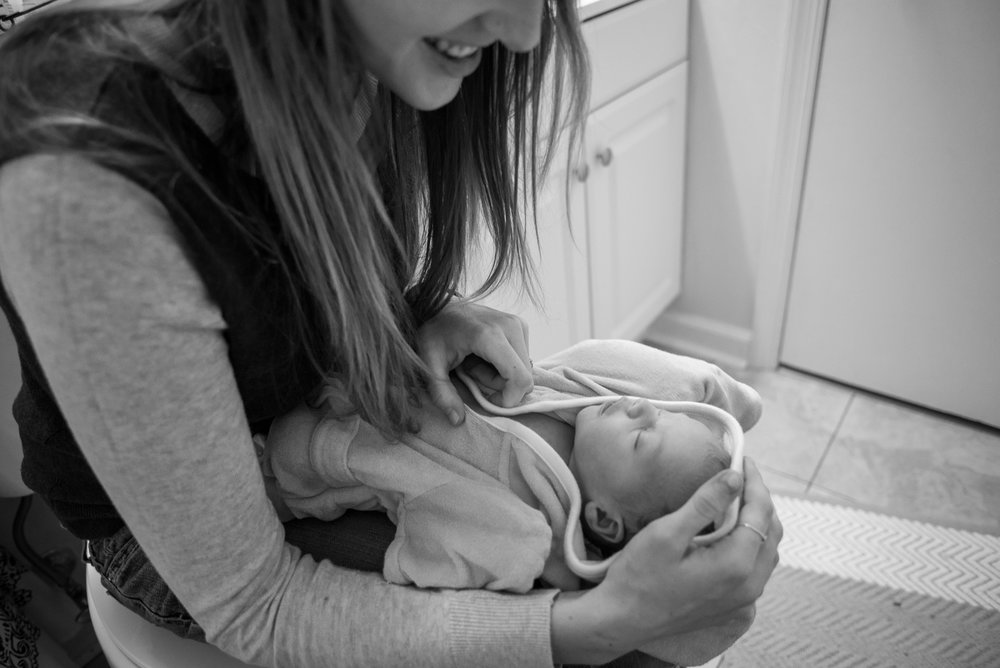 This is one of my favorite photos from the first month of Kira's life - simply because it brings me back to how scared we were to bathe her because she was so tiny and holding her with that baby bath small felt like the most precious thing I'd ever touched.