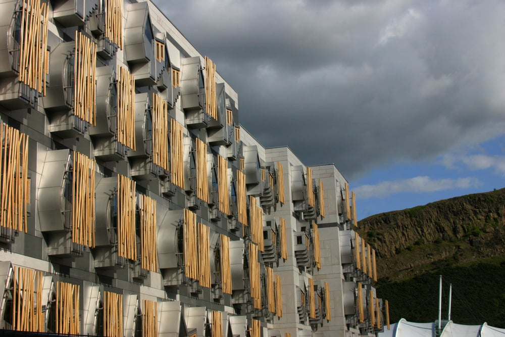West elevation of MSP office block and Salisbury Crags.Picture  Adam Elder.Image © Scottish Parliamentary Corporate Body – 2012. Licensed under the Open Scottish Parliament Licence v1.0.