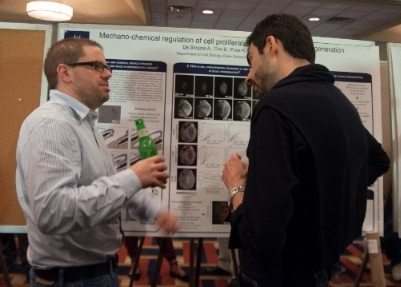 Postdoc in Di Talia Lab Alessandro De Simone (right) discusses his research at the 2017 Retreat with Dr. Michel Bagnat.