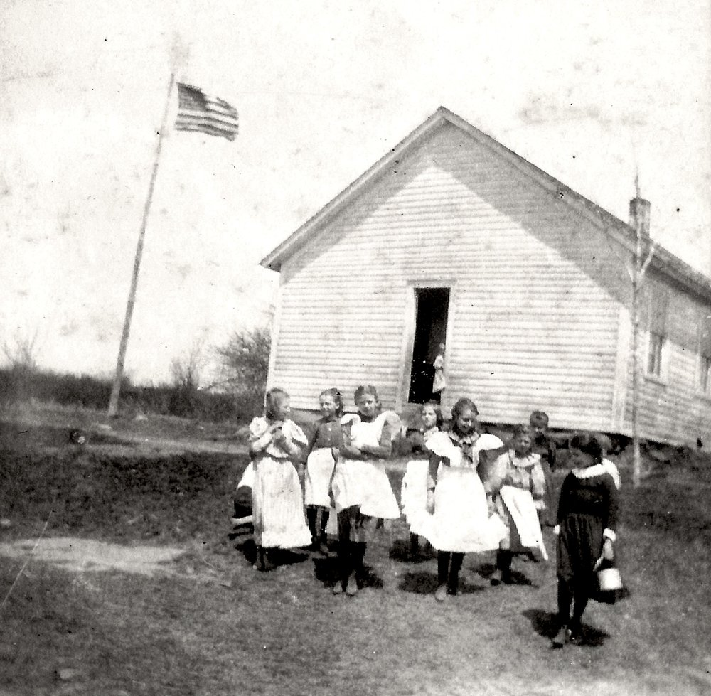A group of students leaving school. This photograph is unidentified, but appears to be Windsor Hill School, also known as #1.