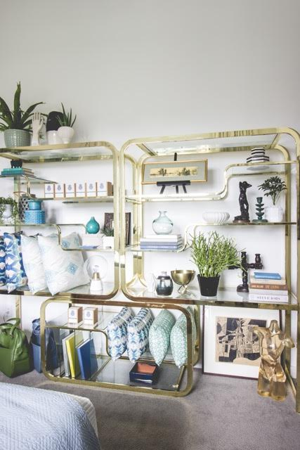 In furniture: this Milo Baughman brass and glass double etagere. This is likely my most valuable possession. Haha. // Photo Credit:  Zach Lucero  //