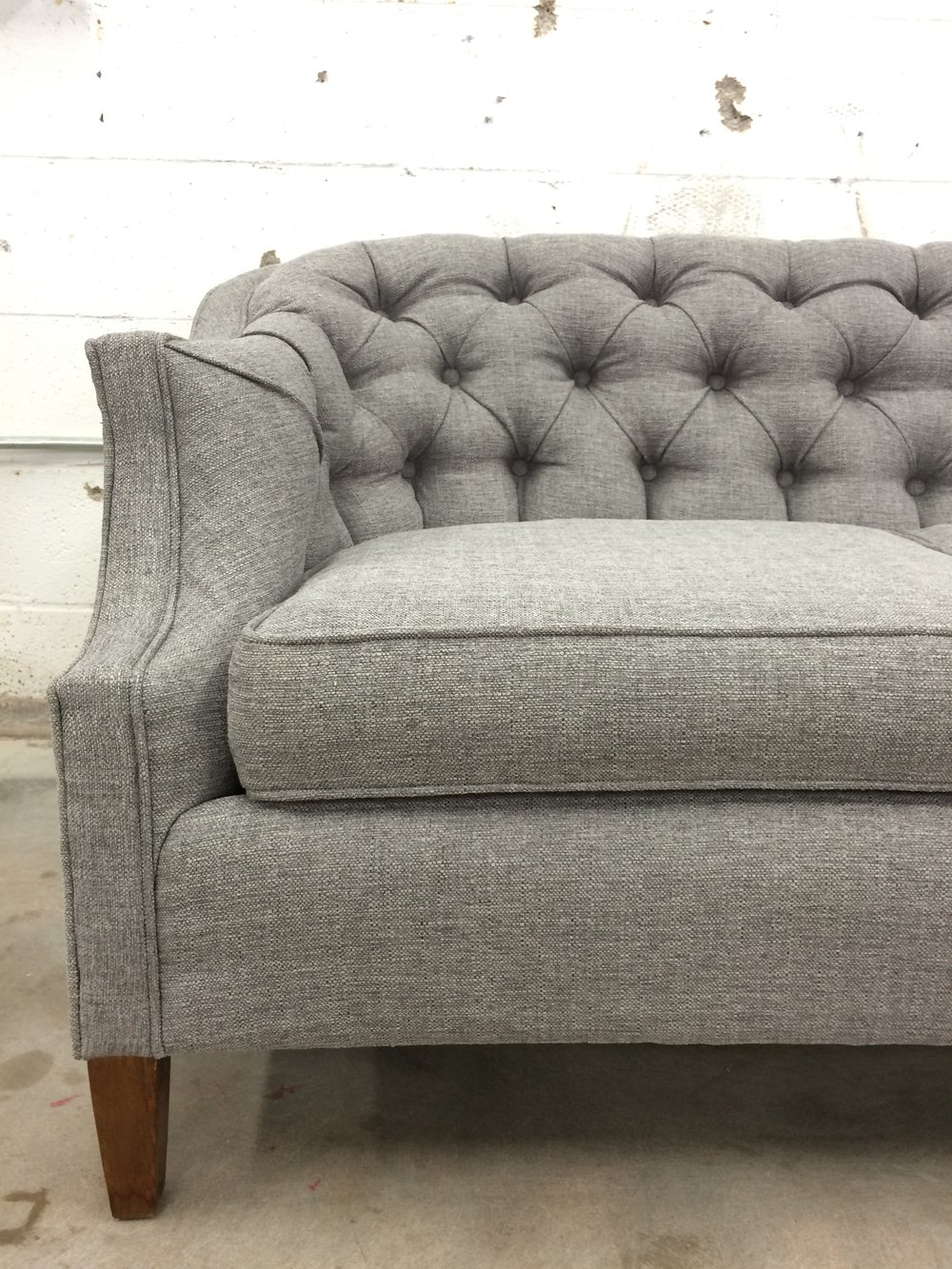 gray tufted vintage sofa