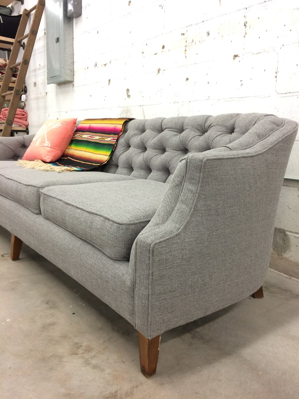 reupholstered tufted sofa