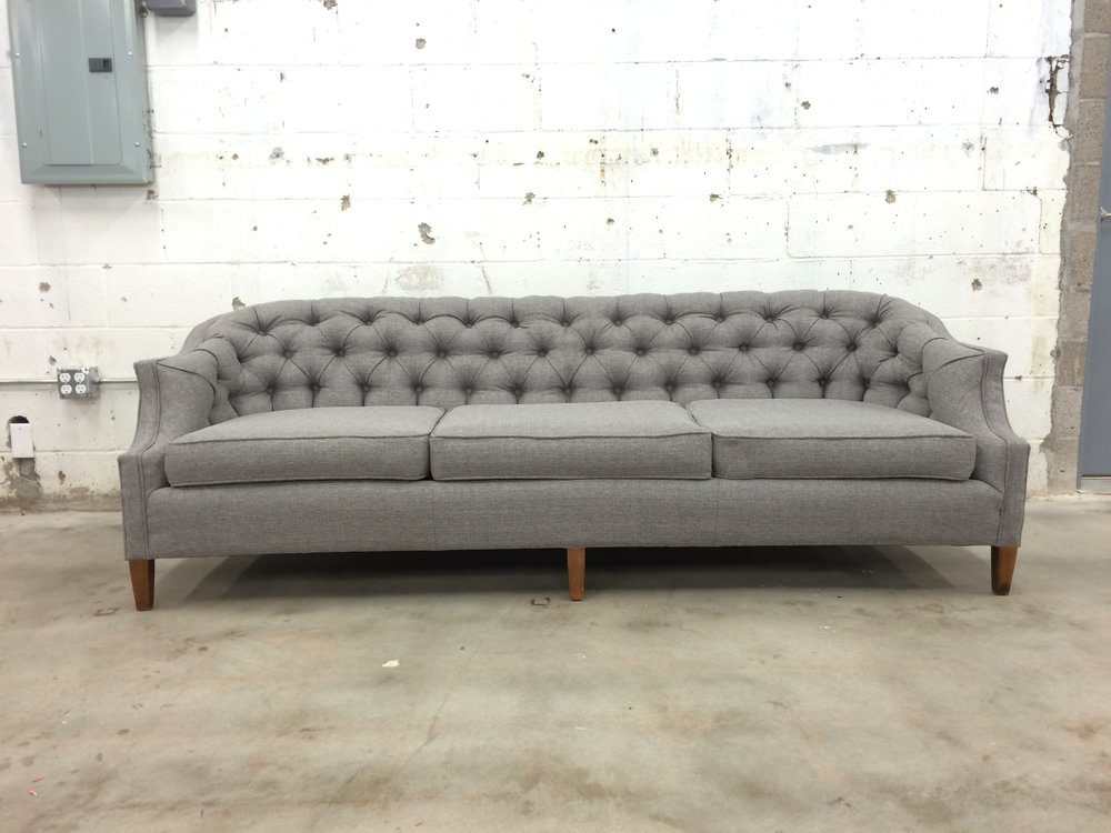 gray reupholstered tufted couch