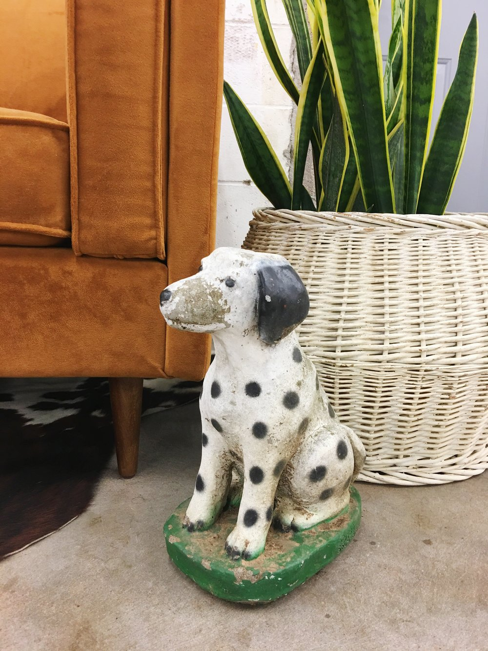 Quirky, unexpected items like this Dalmatian bring warmth to your space.