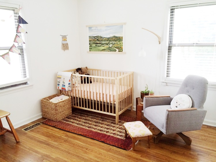 After  Janie's Upholstery  got her hands on it, this rocker became the star of the  bohemian modern nursery .
