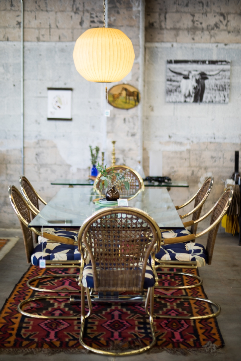 Bohemian modern, vintage eclectic...this is what you find at our shop. My goodness, don't you want to sit on those chairs with your feet on that rug?!