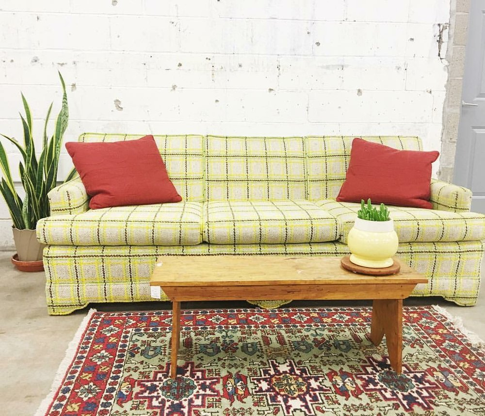 Hello there retro plaid sofa! In this scene it's all about the accessories. This power clash wouldn't be possible without the red solid pillows and the simple yellow planter, soothing and uniting this intense combination.