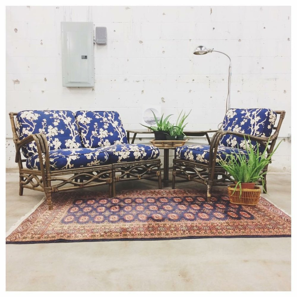 The whimsey of the blue and white floral on the wicker pieces contrasts nicely with the more graphic and uniform pattern on the vintage rug.