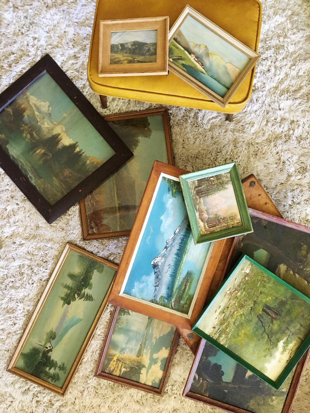 Vintage landscapes Ashley Daly hoarded for her dining room.