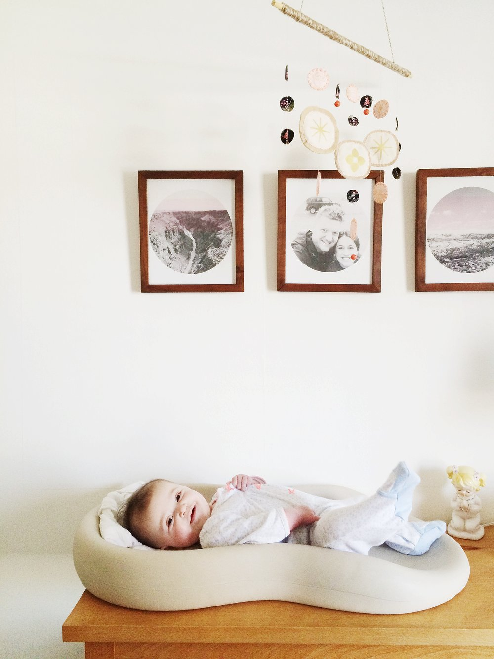 The vintage wooden frames in Harriet's nursery were estate sale scores. Harriet loves them.