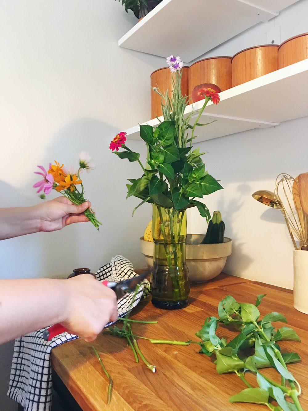 arranging wildflower cuttings