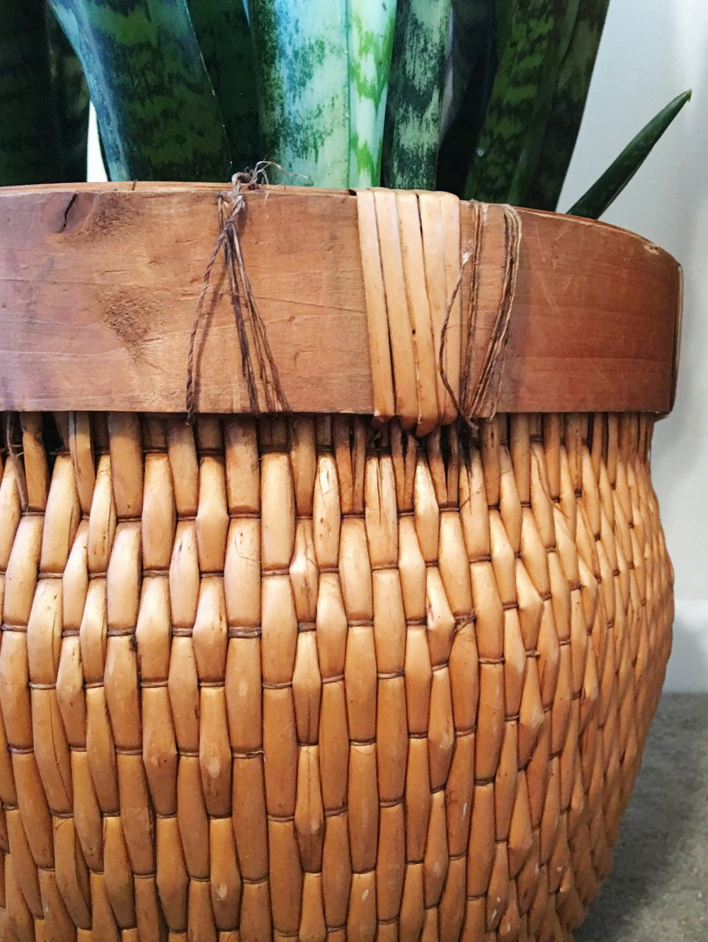 This vintage plant basket adds a whole lotta rustic earthy vibe to the bedroom.