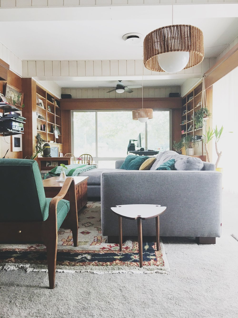 This vintage rug used to be in my dining room, but I decided I liked it better in the den. It's a wonderful thing to  constantly move things around your house . It makes them feel new! Also, note we also changed out the fan for something more modern.