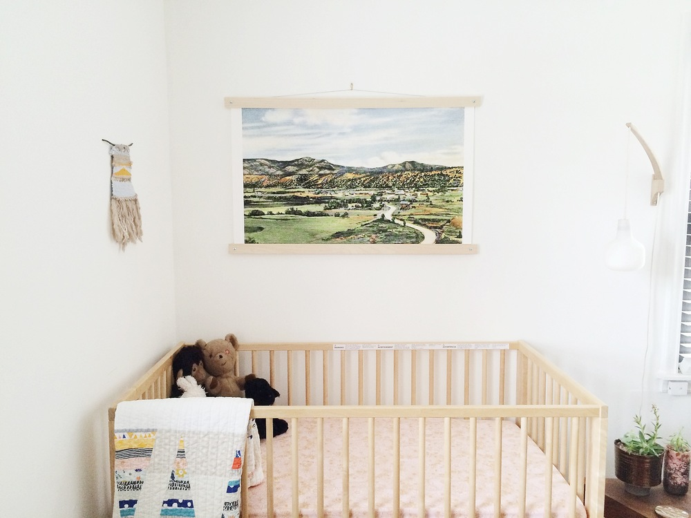 Blushes, dusty oranges and soft, whimsical patterns galore. From the crib sheets and hand-made quilt to the landscape postcard artwork and wall weaving (by  House Sparrow Fine Nesting! ), these colors and patterns work together to unite not only the nursery, but the entire home.