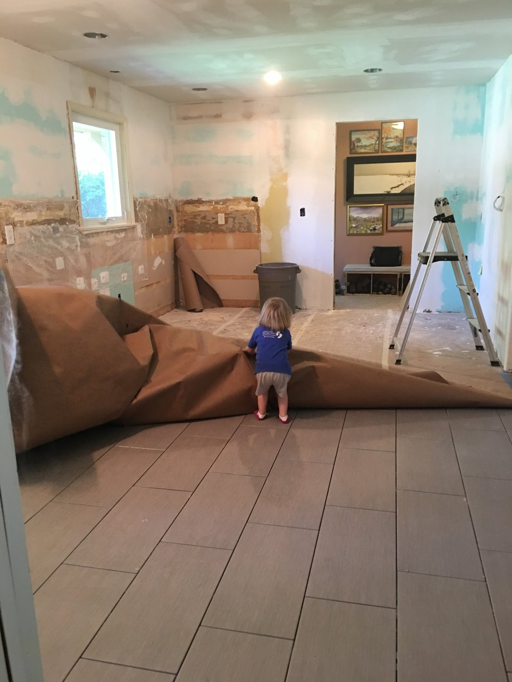 Here's little Caroline revealing the new floor my brother installed. What a good day that was!