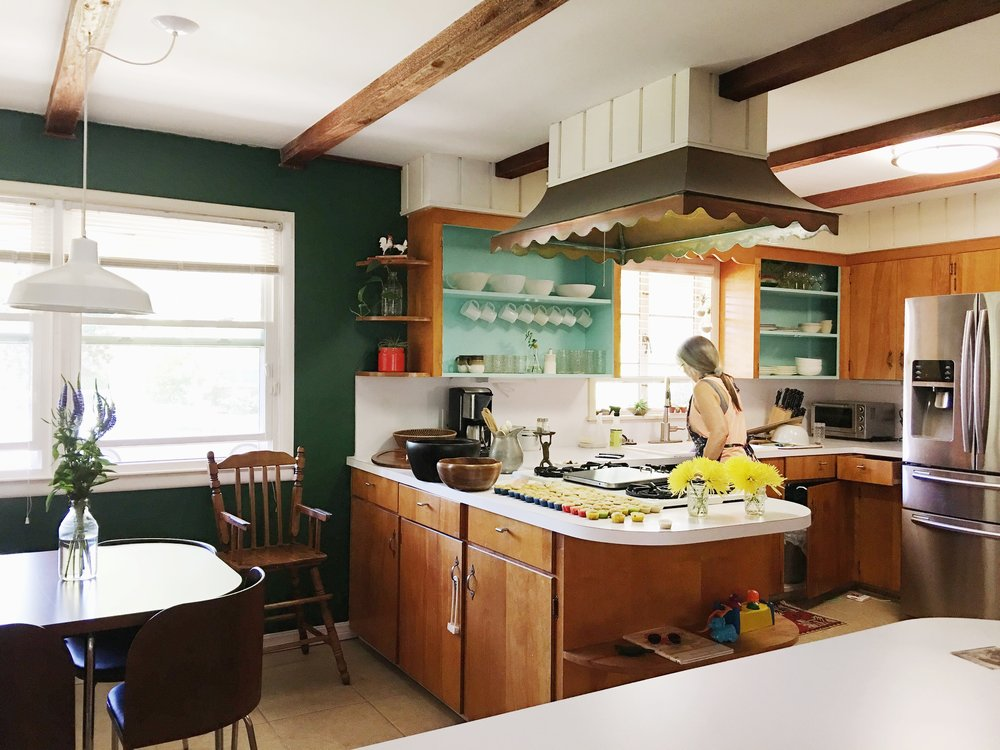 Our 1950s kitchen looked like this before. It was definitely not the worst kitchen ever, but was kinda blah compared to the rest of the house and also had some functional issues.