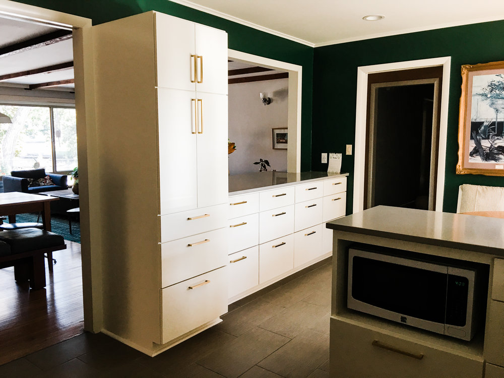 Here's a better photo of the pantry. There used to be NOTHING in that space before- just a blank wall between the door and the pass-through. Can you believe it? Not only did we make more efficient use of space, but the location in the middle of the kitchen, equally close to the eat-in table and the stove, is even more perfect than before (in the far corner).
