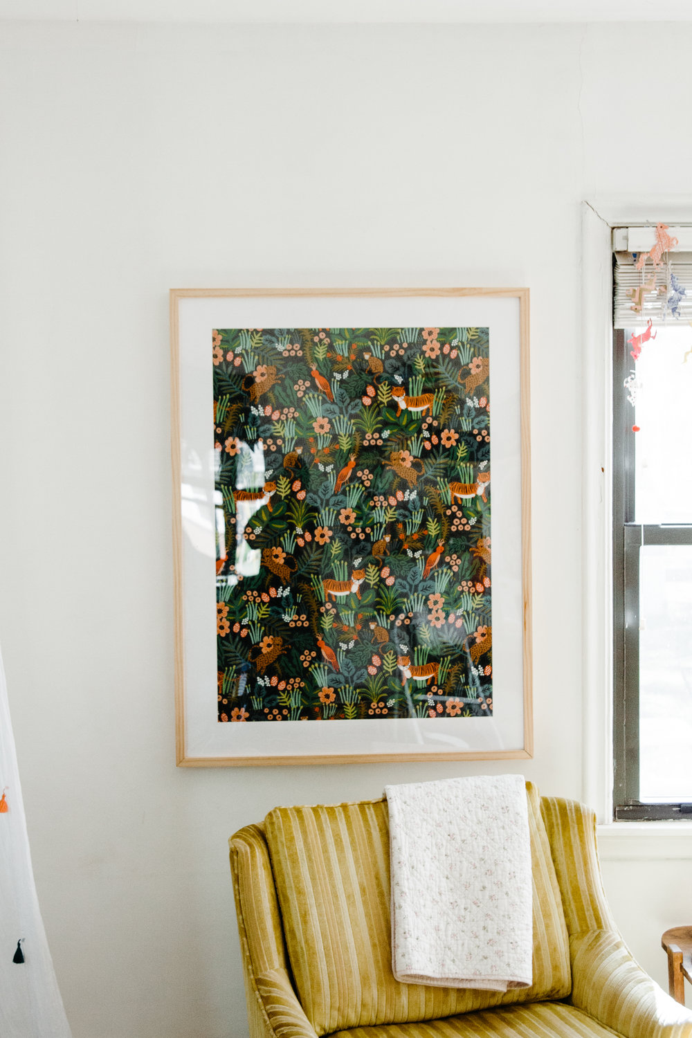 Daly put her framed Rifle Paper Co. fabric art up, and it has changed the face of her sunroom. Blog post to follow!