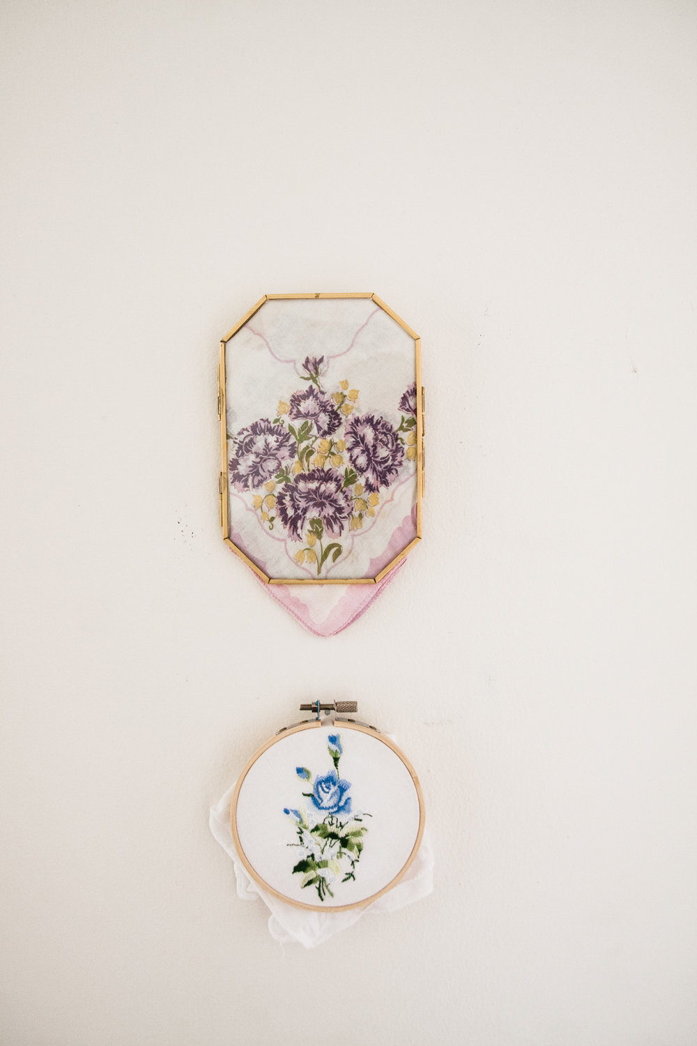 Emily framed her grandmother's handkerchiefs and displays them in her hallway.