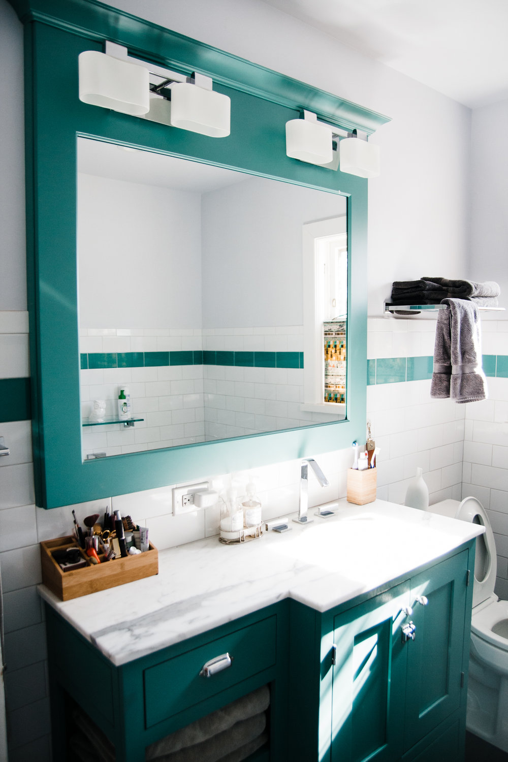 Allison's father built the custom vanity as well. We love the green throughout the space.