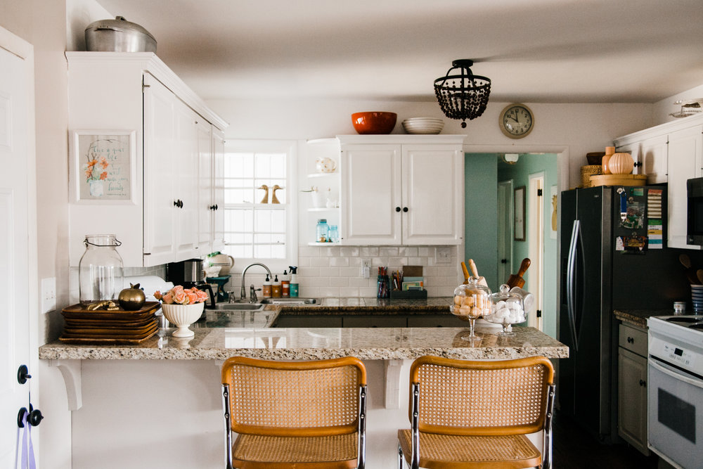 The home's kitchen is open to the dining/music room.
