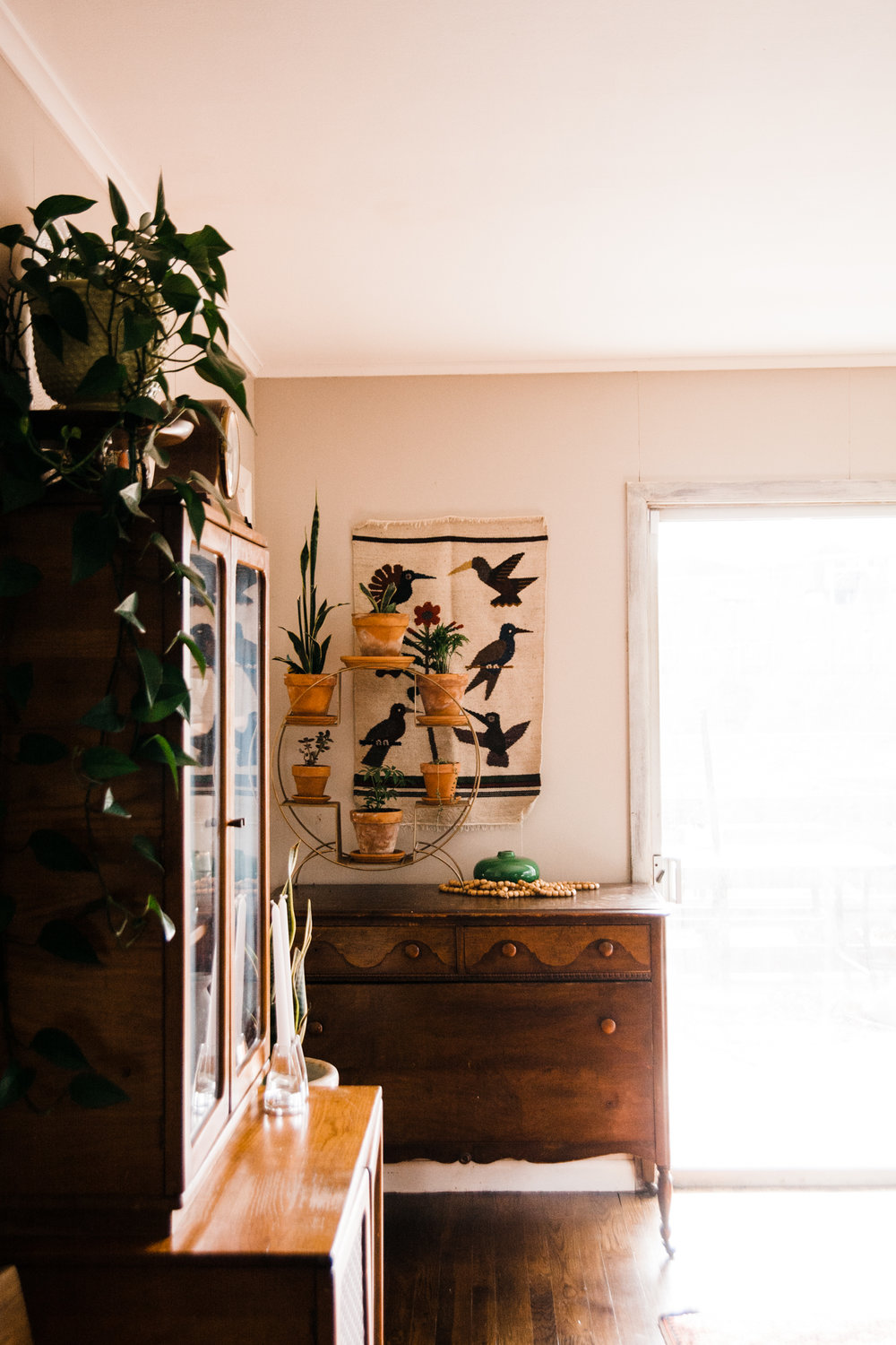 We love the primitive wooden pieces throughout the home.