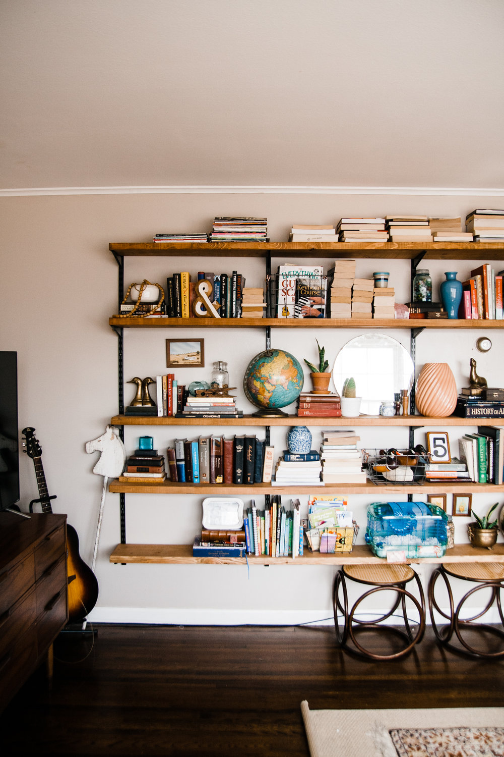 Rachel and her husband installed the open shelving in the living room themselves.