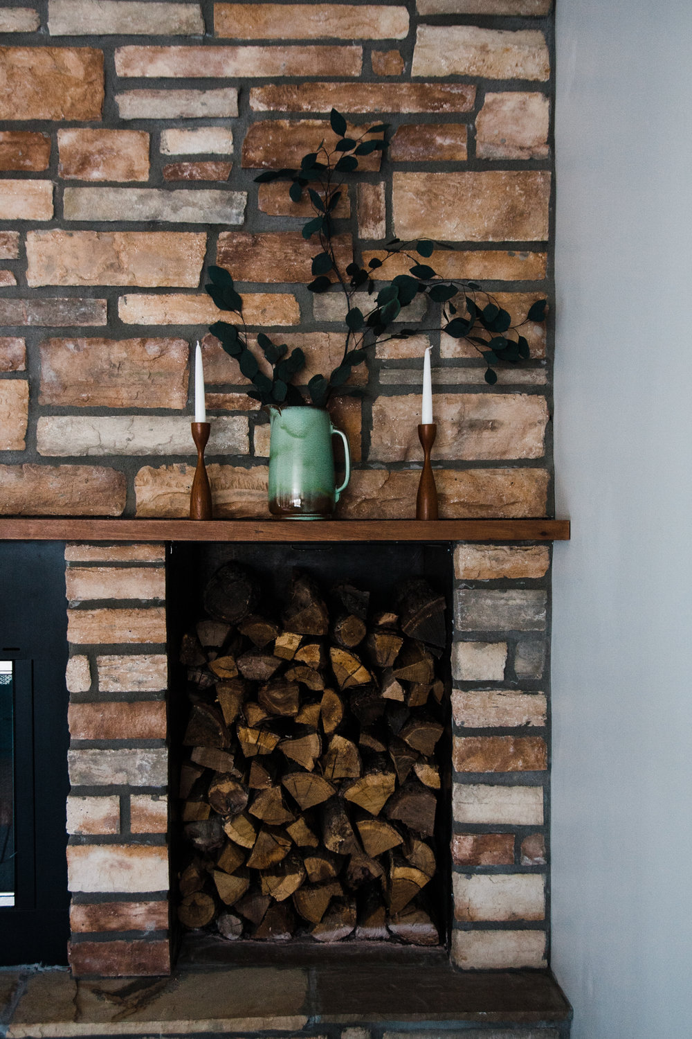 We love the combination of the fireplace stone and the stacked wood.