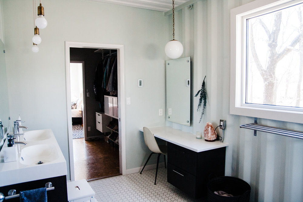 The first-floor bathroom is connected to the master bedroom and the main living area.