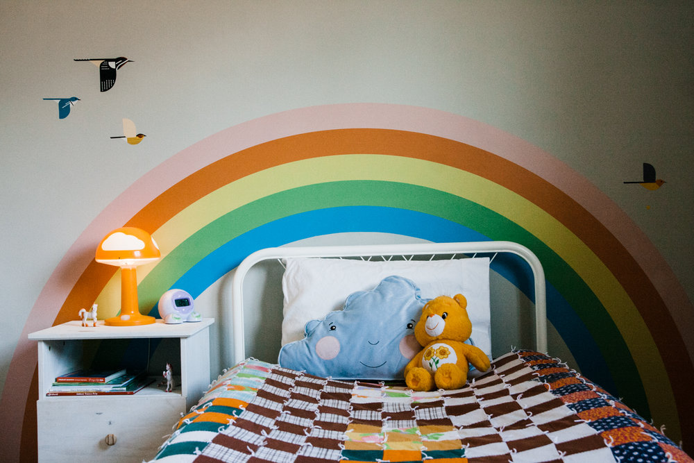 The rainbow and birds are vinyl decals that can be easily removed.