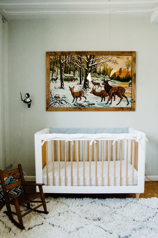 The artwork is a framed vintage rug.